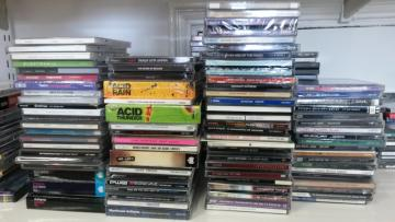 Photo of CDs, stacked and ready for transferring